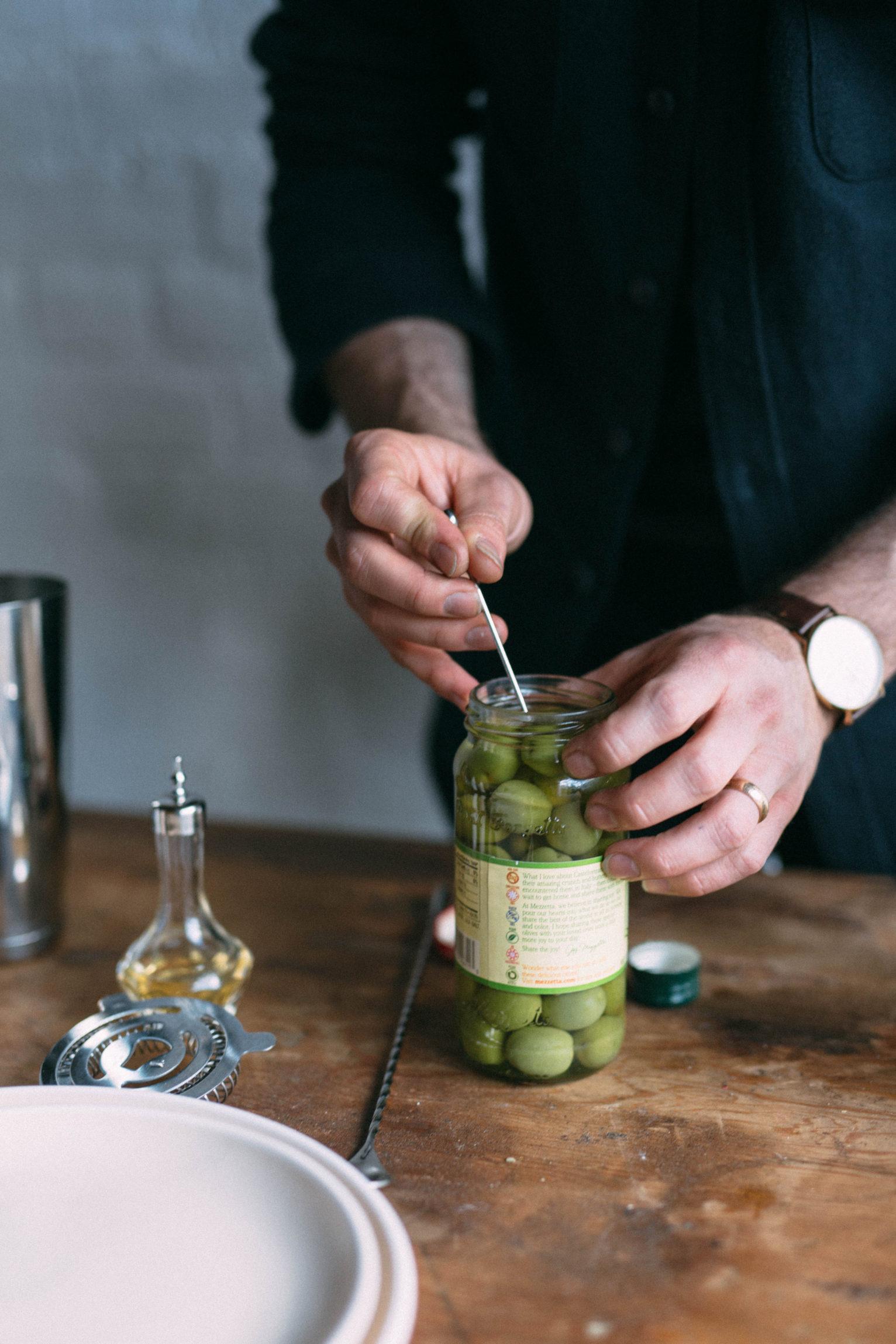 Prepping olives for garnish