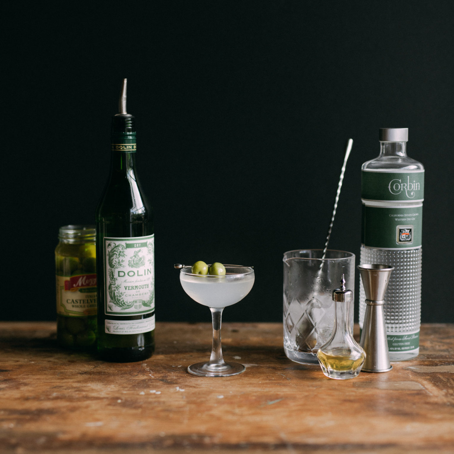 Dolin Dry Vermouth, Martini Glass, Bitters Bottle, Jigger, Corbin Gin