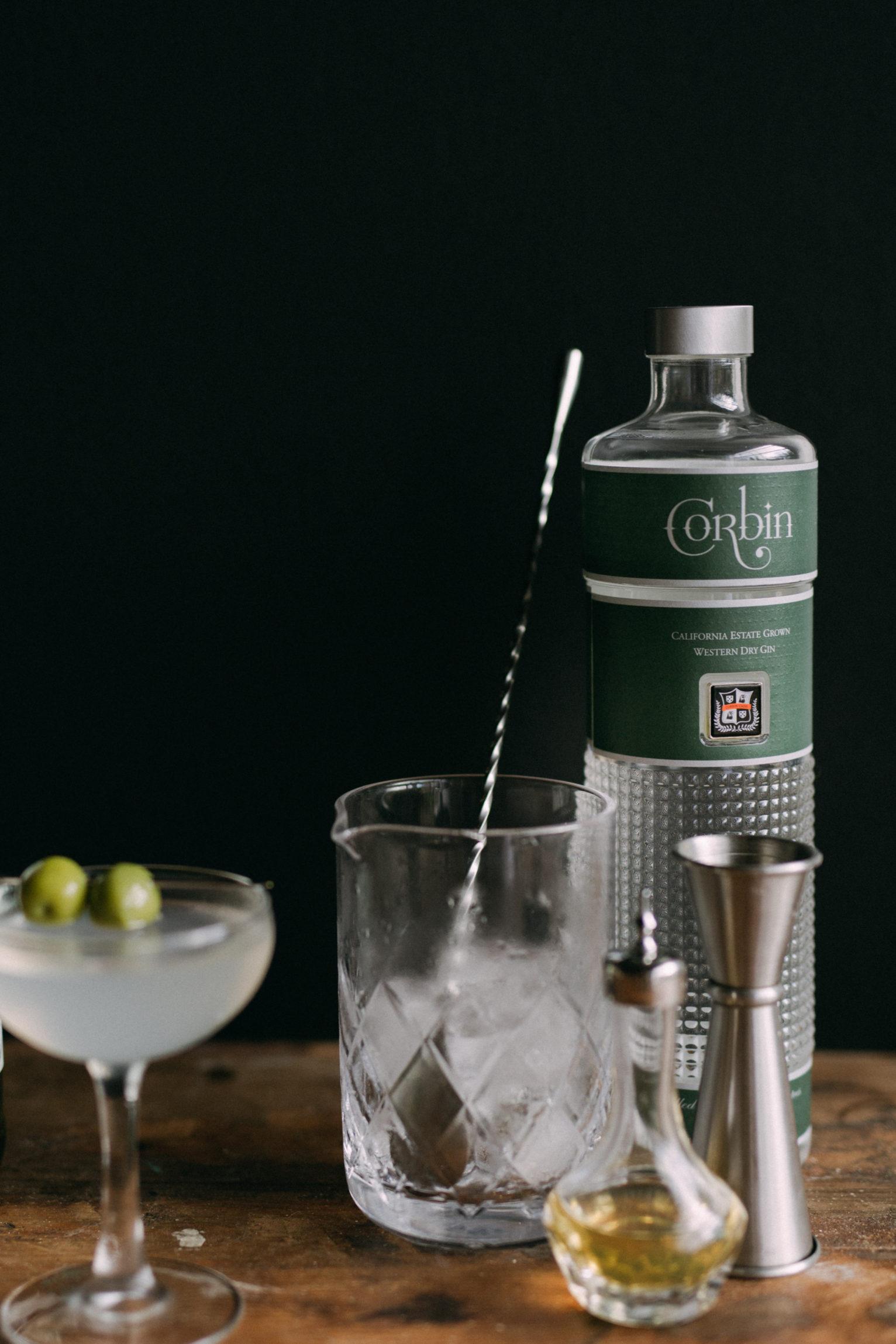 Dolin Dry Vermouth, Martini Glass, Bitters Bottle, Jigger, Corbin Gin