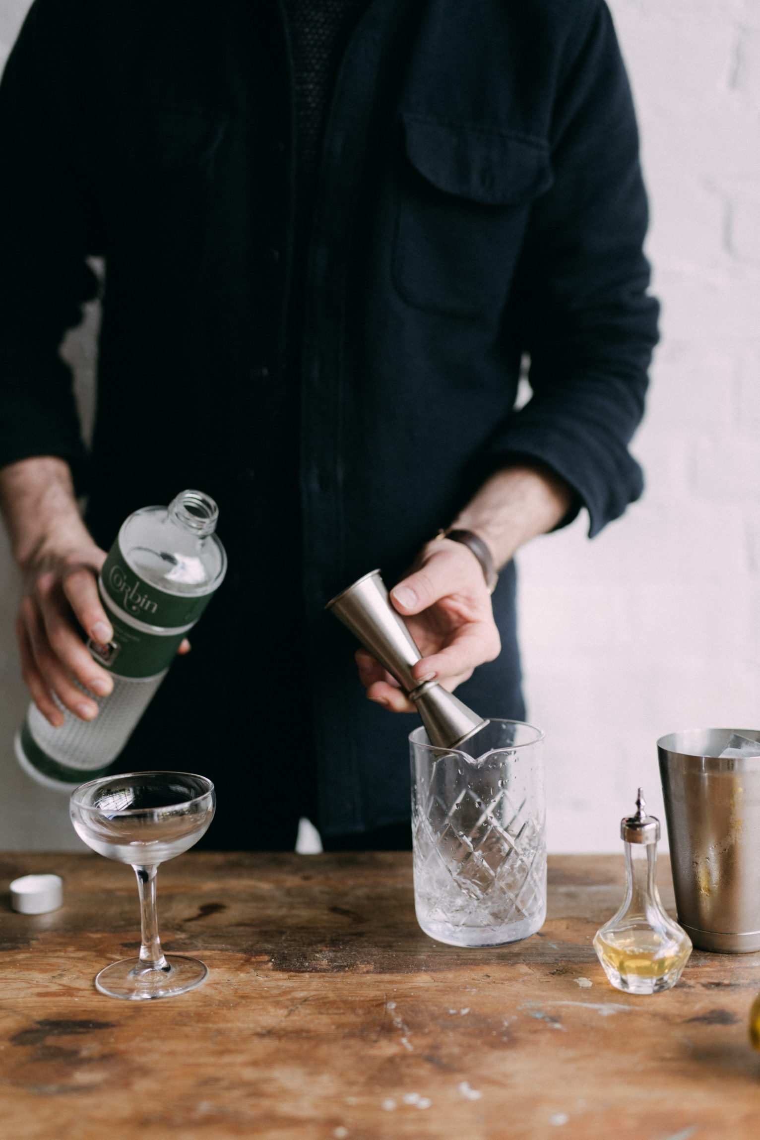 Pouring Gin into Mixing Glass