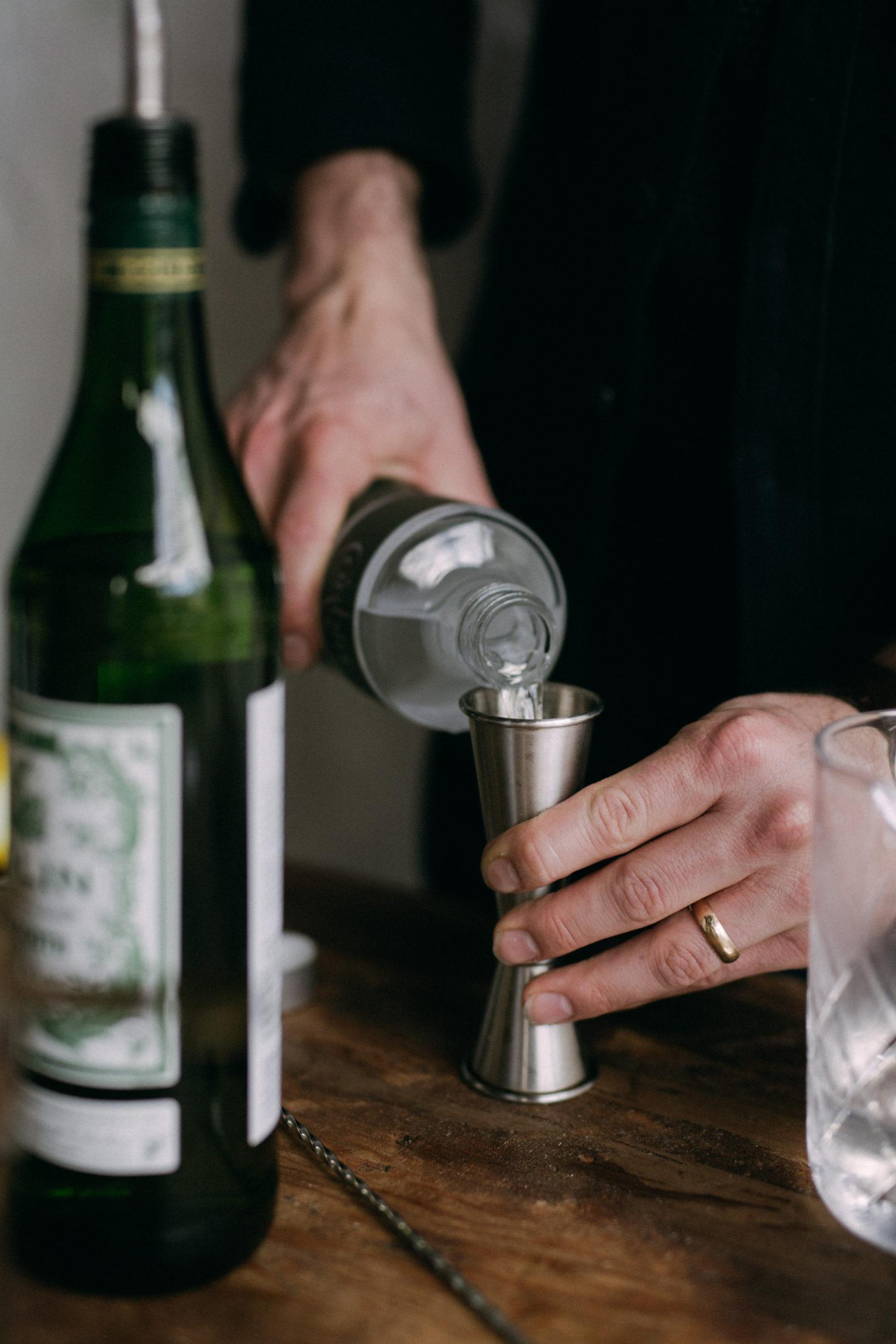 Pouring Gin into a Jigger