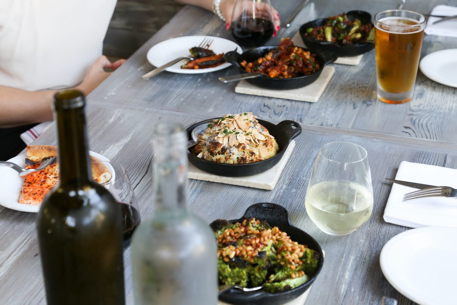 Dinners enjoying locally-sourced food