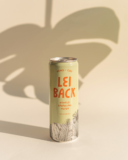 Lei Back Pomelo can with monstera leaf shadow casted behind