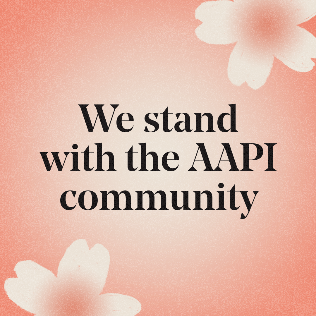 """Serene flower blossoms framing the words, """"We stand with the AAPI community"""""""